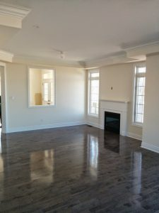 Barrie complete home renovation-luxury family room with wooden floor and build in fire place