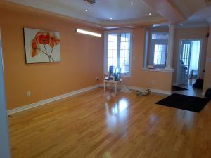 amazing living room with orange wall paint and columns decor north york