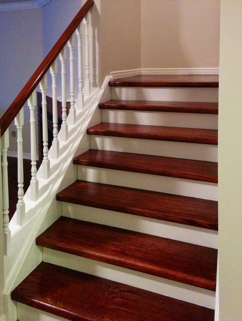 amazing stair case with red wood stairs and railings aurora