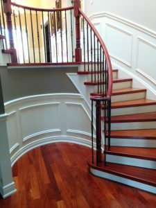 amazing staircase-renovation-gray wall painting and red wood floor and stairs Markham