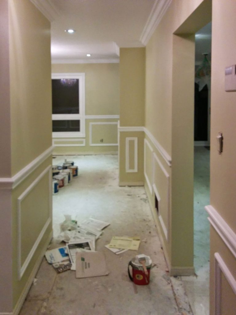 beige wall painting and Wainscoting wall trim in custom home king city