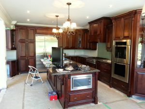 classic wood trim kitchen with build in appliance Richmond hill