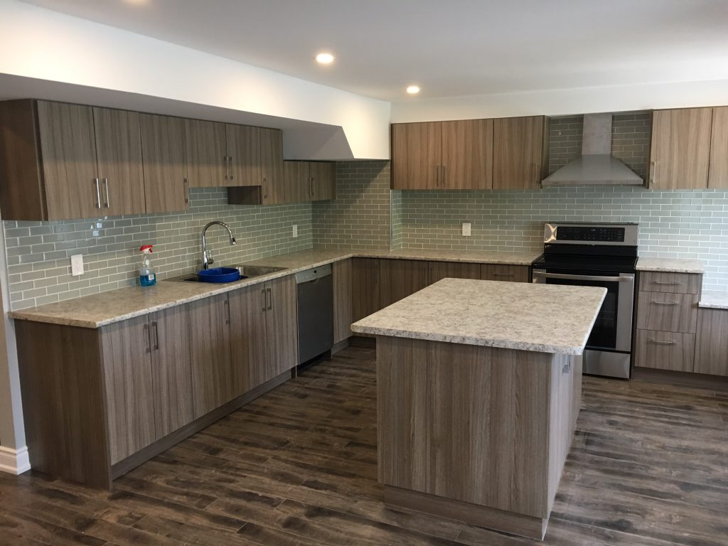custom kitchen renovation with luxury wooden cabinets and floor king city