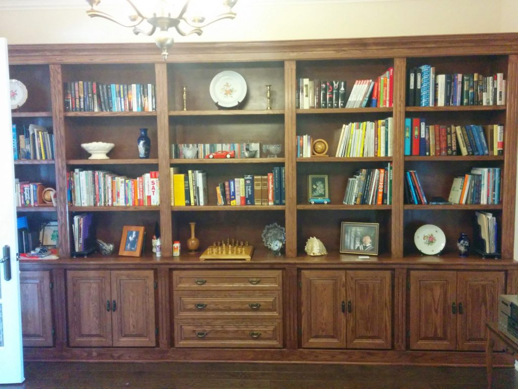 custom library bookshelves in custom home aurora