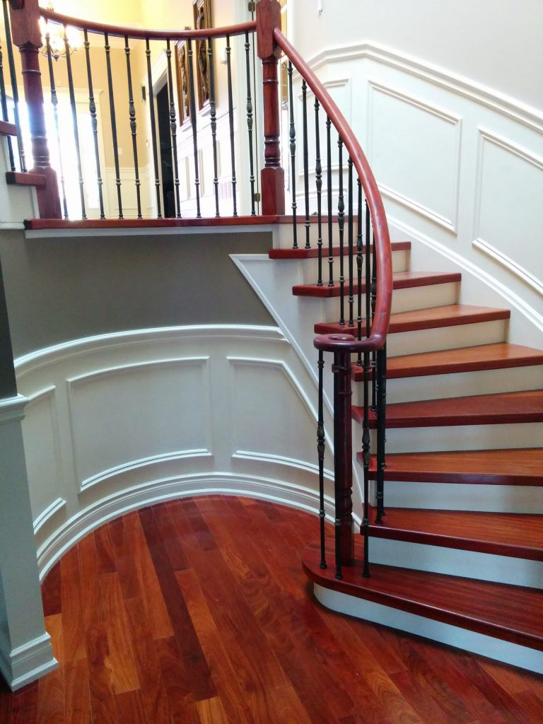 custom staircase with red railings and Wainscoting wall trim woodbridge
