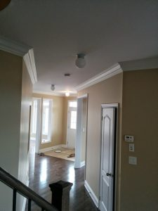 home remodeling project - luxury hallway with crown moulding, wall painting and flooring Bradford