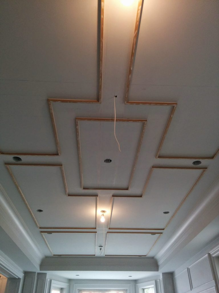 in progress of installing coffered ceiling in custom home king city