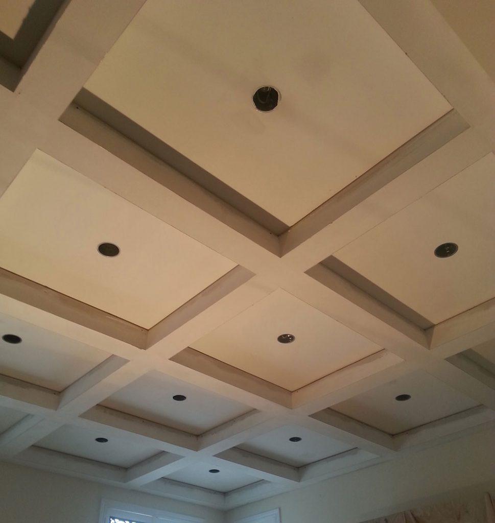 in progress of installing waffle ceiling in luxury living room woodbridge