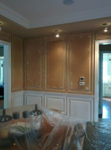 in progress of painting coffered wall trim to white color by refined renos Barrie