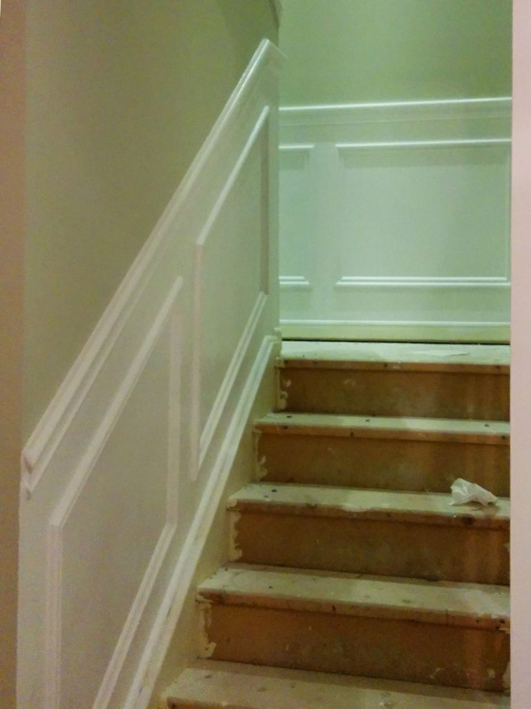 in progress of staircase renovation and Wainscoting wall trim install aurora