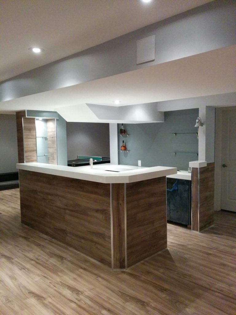 low ceiling bar with wooden panel decor and storage shelves - basement reno ideas by refined renos Aurora