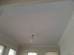 luxury living room with custom ceiling with crown molding markham