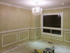 luxury living room with wall Wainscoting trim under the window newmarket