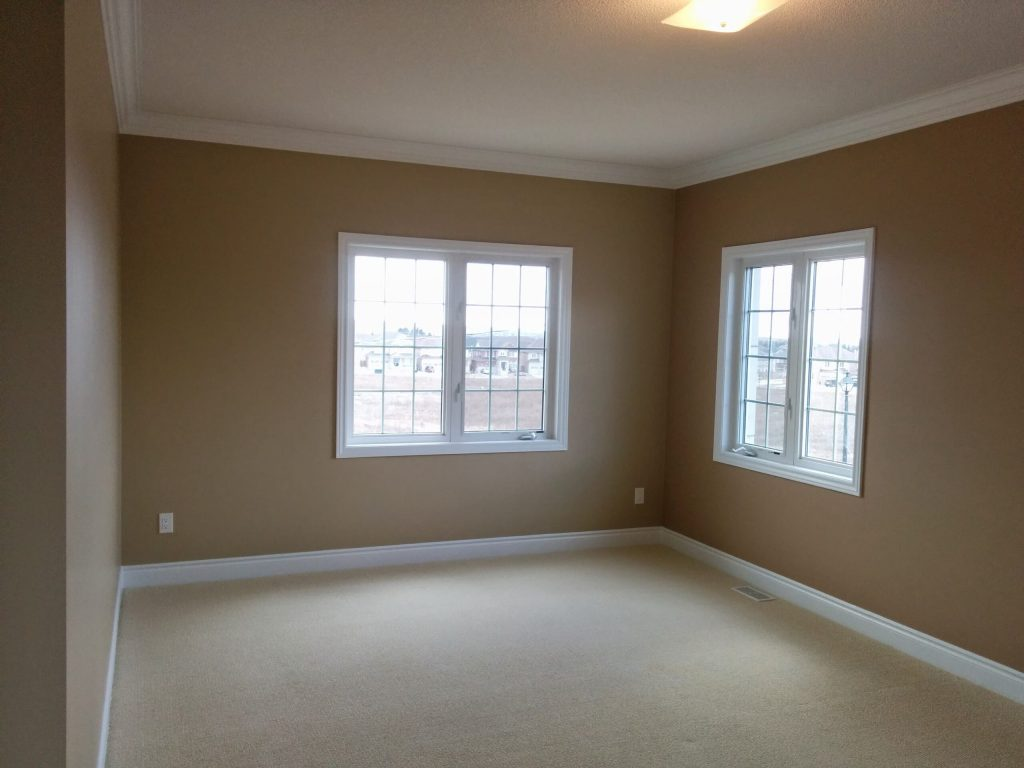 modern bedroom with crown moulding and baseboard trim - home renovations Richmond hill