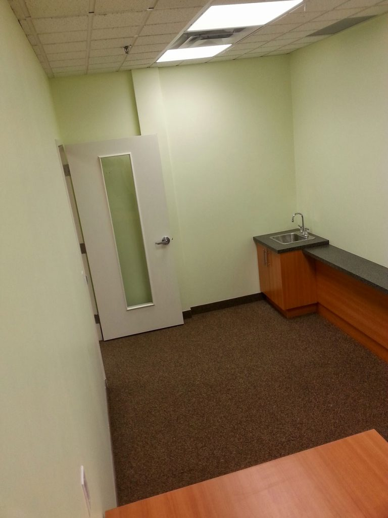 office kitchen renovation with green wall paining and small sink vanity Richmond hill