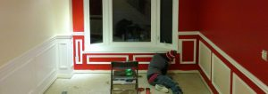 red wall with window and Wainscoting trim newmarket