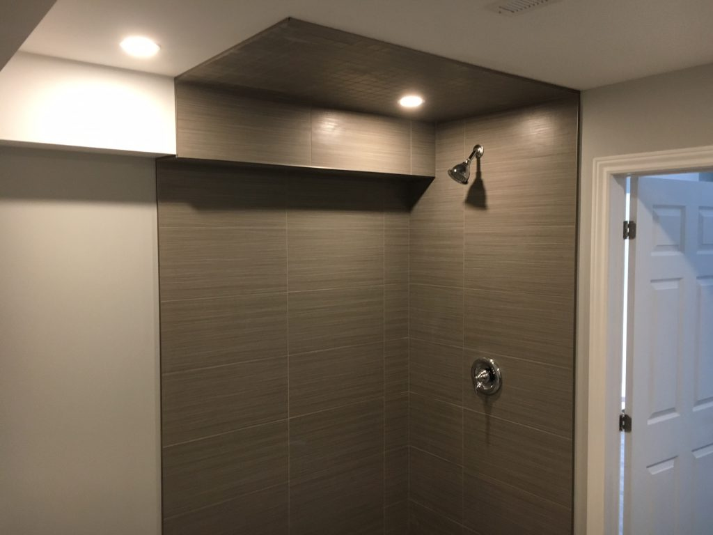 bathroom reno ideas - two ton bathroom with brown and beige wall painting