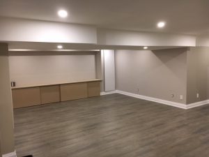 custom basement with baseboard trim and ceiling pot lights north york
