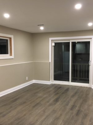 walk out basement with baseboard trim and beige wall painting - house renovation
