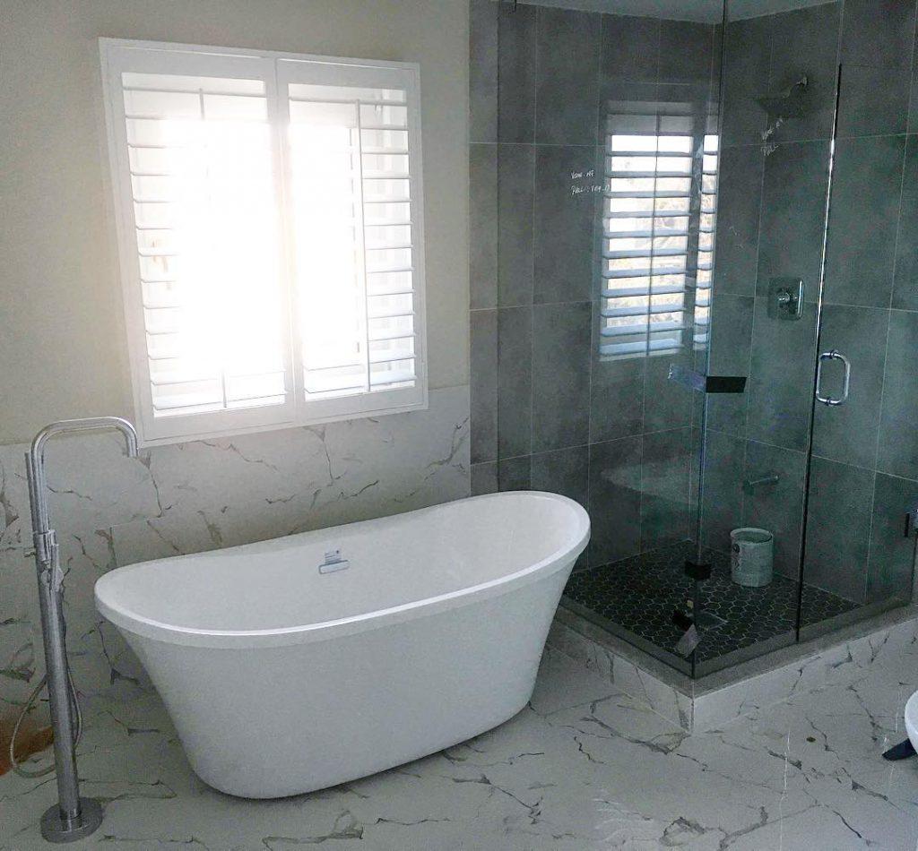free standing bathtub and walk in shower in amazing bathroom reno