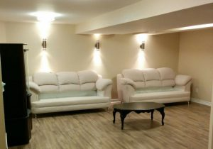toronto basement renovation with white sofa and wooden floor newmarket