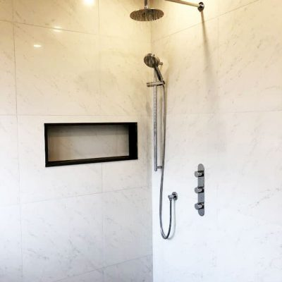 custom shower with build in storage space - bathroom design,