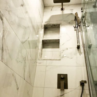 bathroom renos - 3 way shower kit in luxury shower with build in storage space