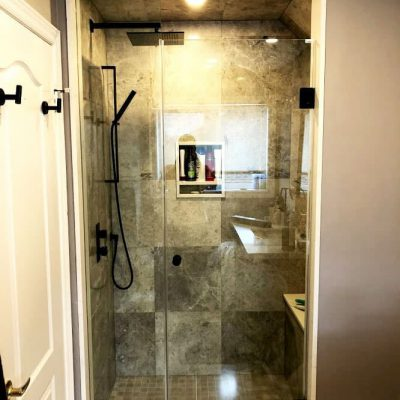 amazing shower with tile wall decor and glass enclosure - washroom renovation