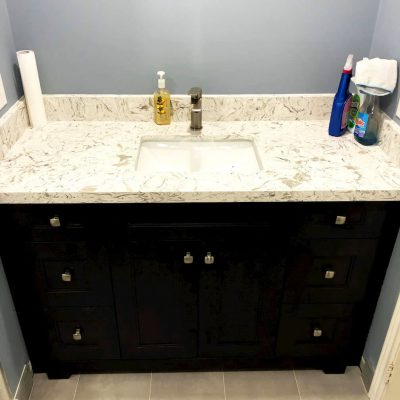 small black vanity with marble counter top - bathroom renovations