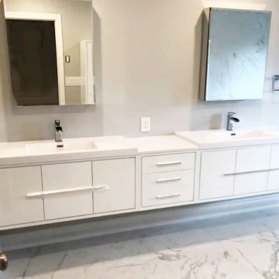 wall mount vanity and double sink and mirror in custom bathroom - bathroom renovation