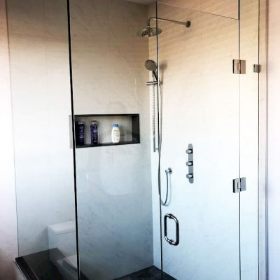 glass enclosure  and build in storage space in amazing shower - bathroom renovation ideas
