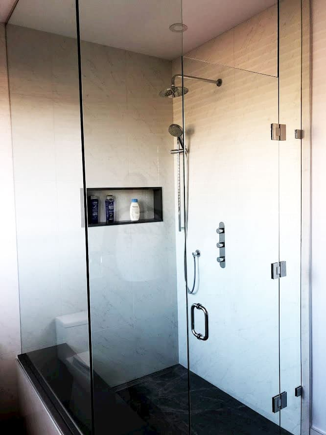 custom shower with glass enclosure and build in storage space -  bathroom renovation ideas