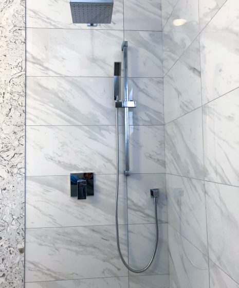 marble tile decor in custom shower - washroom renovation