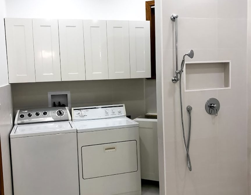 luxury bathroom / laundry room with walk in shower - house renovation