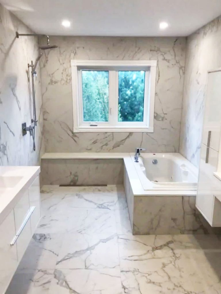 custom bathroom with marble wall and floor decor - bathroom reno ideas