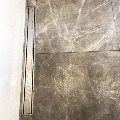 custom wall decor made from marble tiles in luxury shower - bathroom renovation