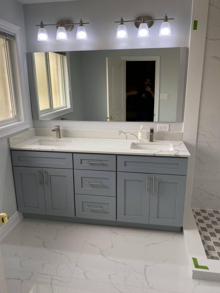 blue vanity in luxury finished bathroom