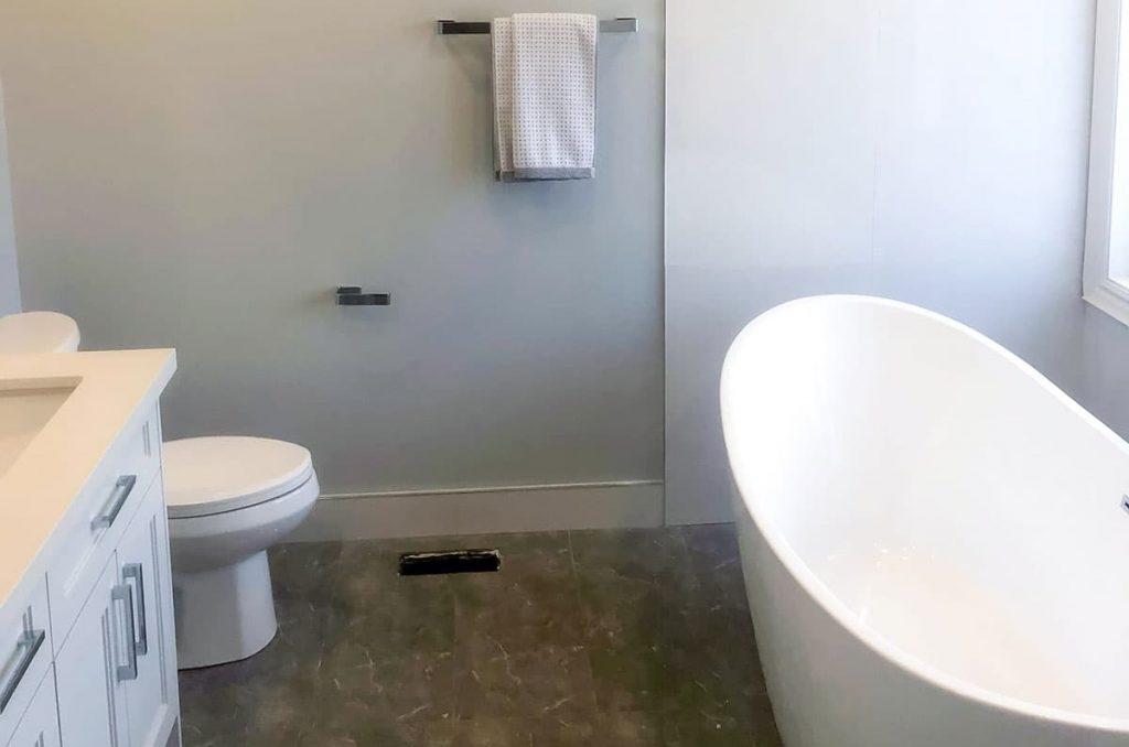 freestanding bathtub and white vanity in amazing bathroom renovations
