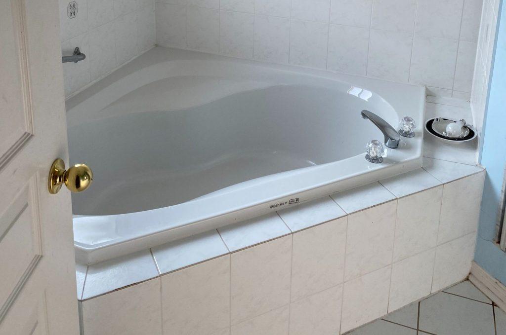 custom hot tub in luxury bathroom - bathroom renovation by refined renos toronto